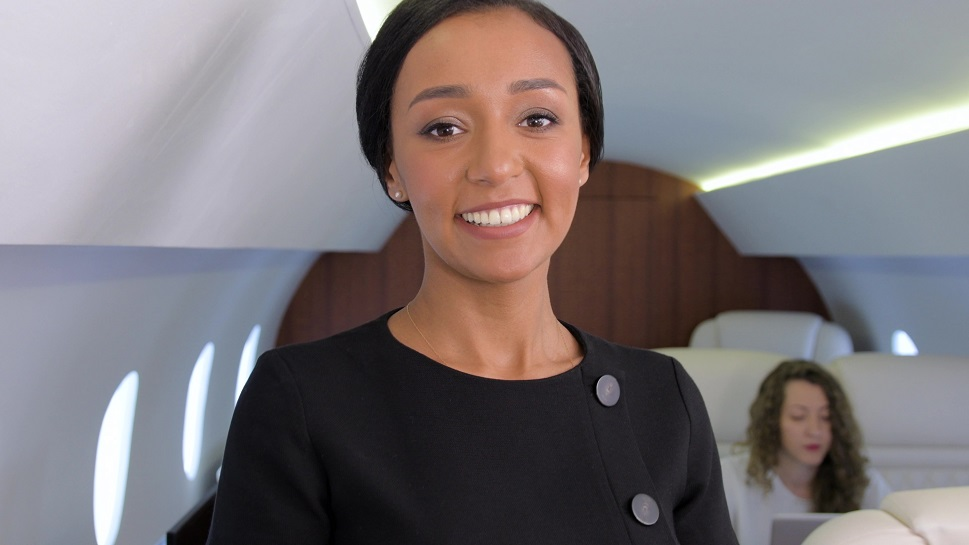 Air Stewardess tending to private jet passengers