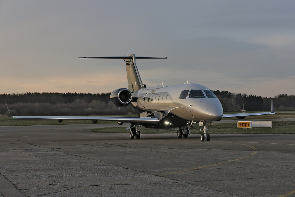 An Embraer Legacy 500 taxis towards the airport apron
