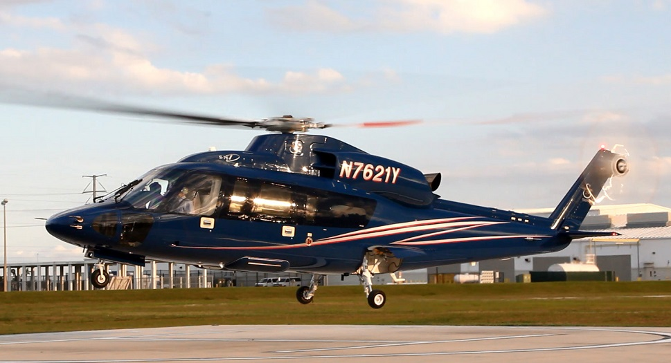 A Sikorsky S-76D helicopter taking off from helipad