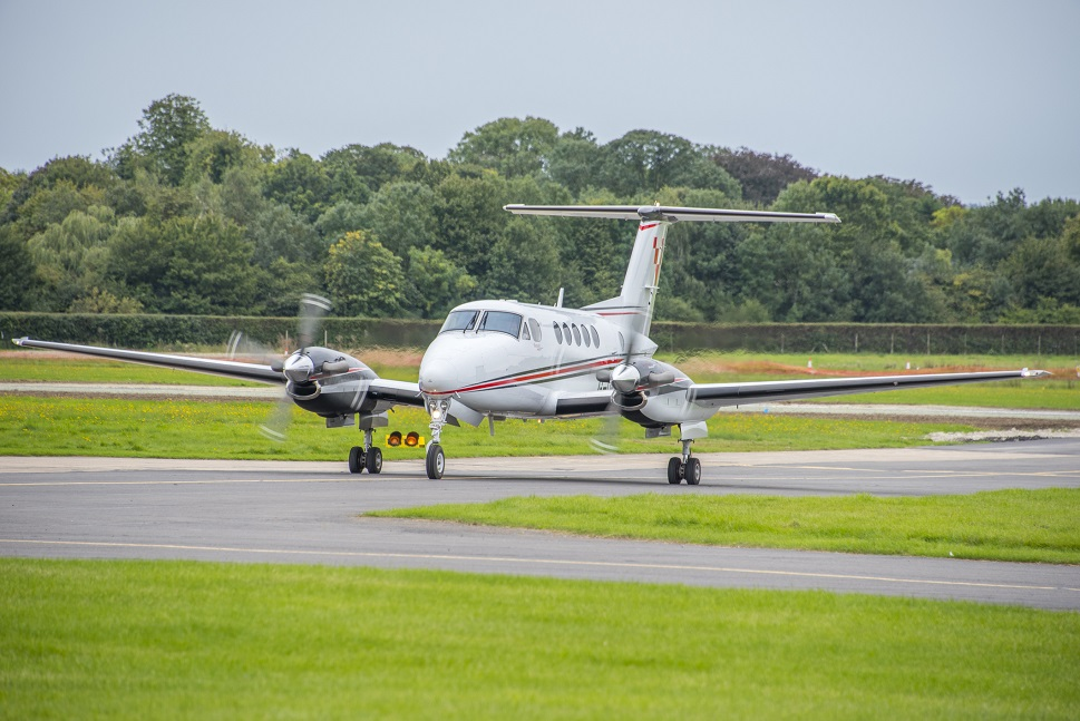 Beechcraft King Air taxis away from the runway
