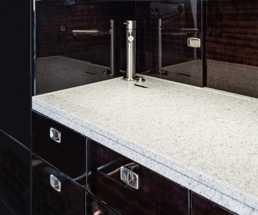 Embraer Legacy 500 refurbished galley area with granite counter
