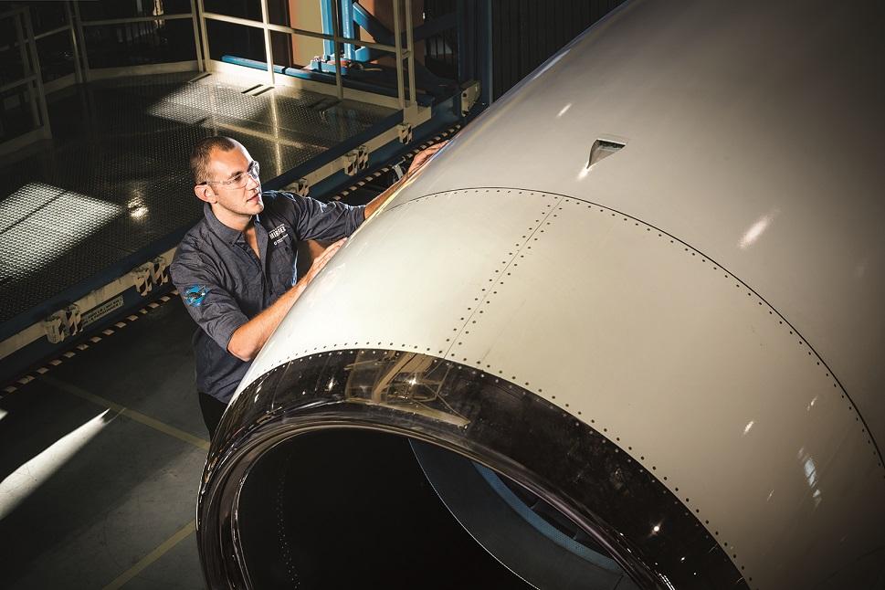 Pratt & Whitney Canada maintenance technician inspects a private jet engine
