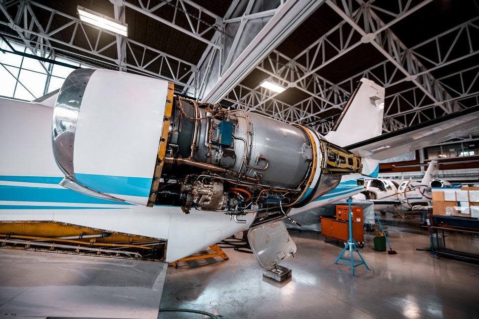 A Cessna Citation private jet undergoes engine maintenance