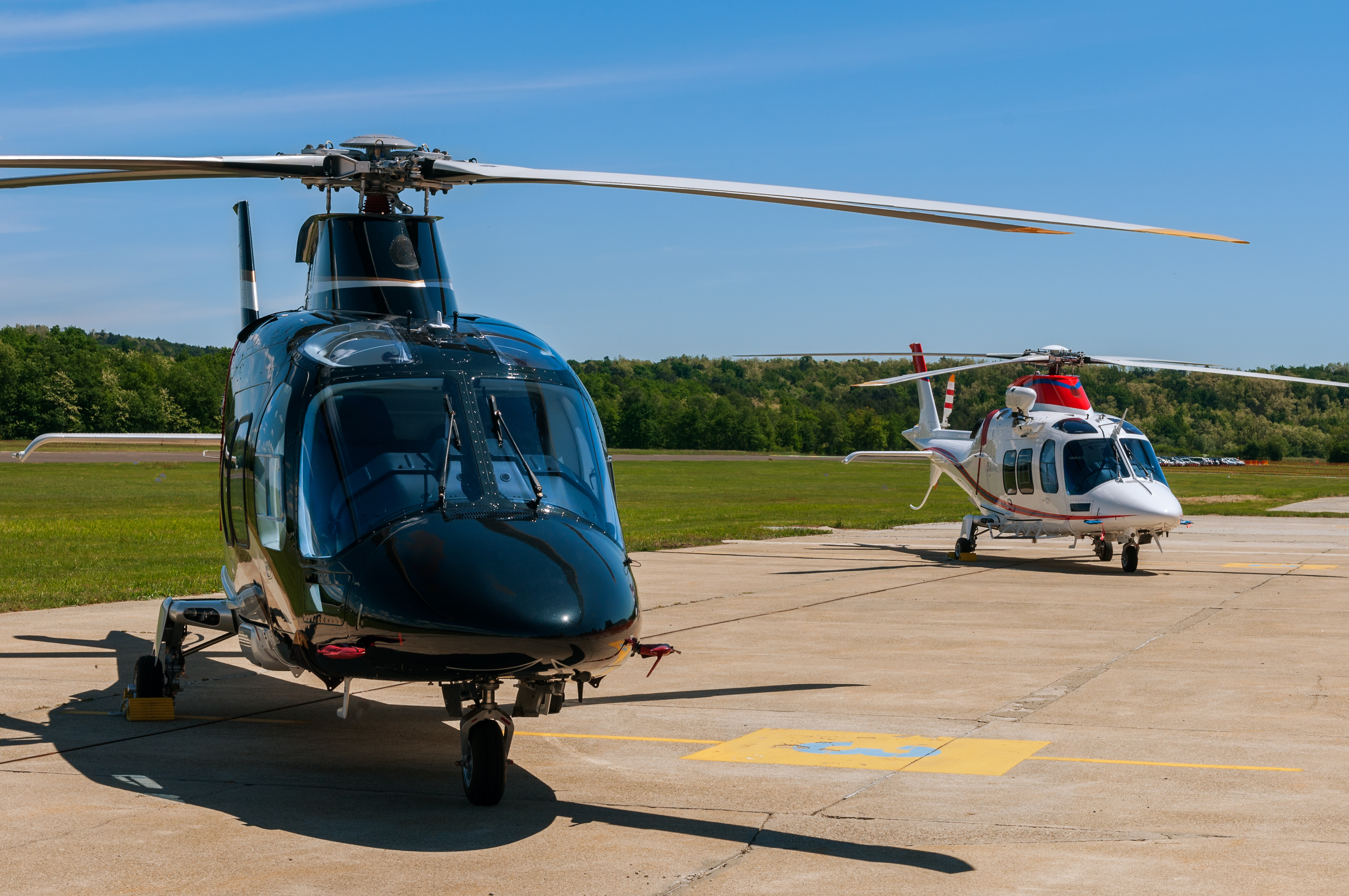Two helicopters on a runway