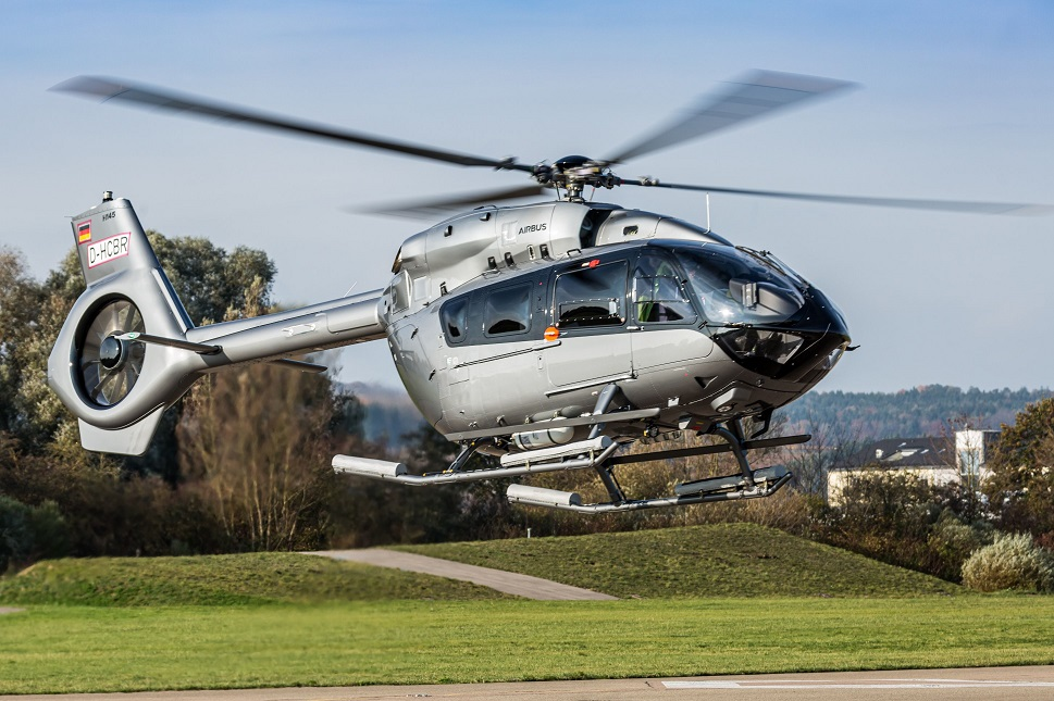 An Airbus H145 hovers above airport apron