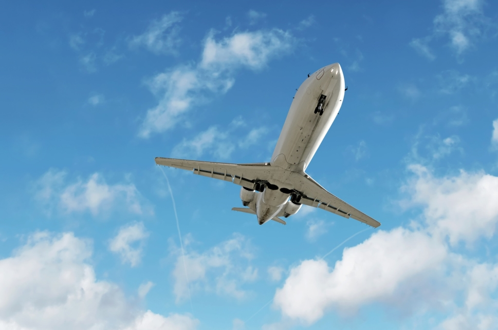 Private jet flies overhead leaving trailwinds