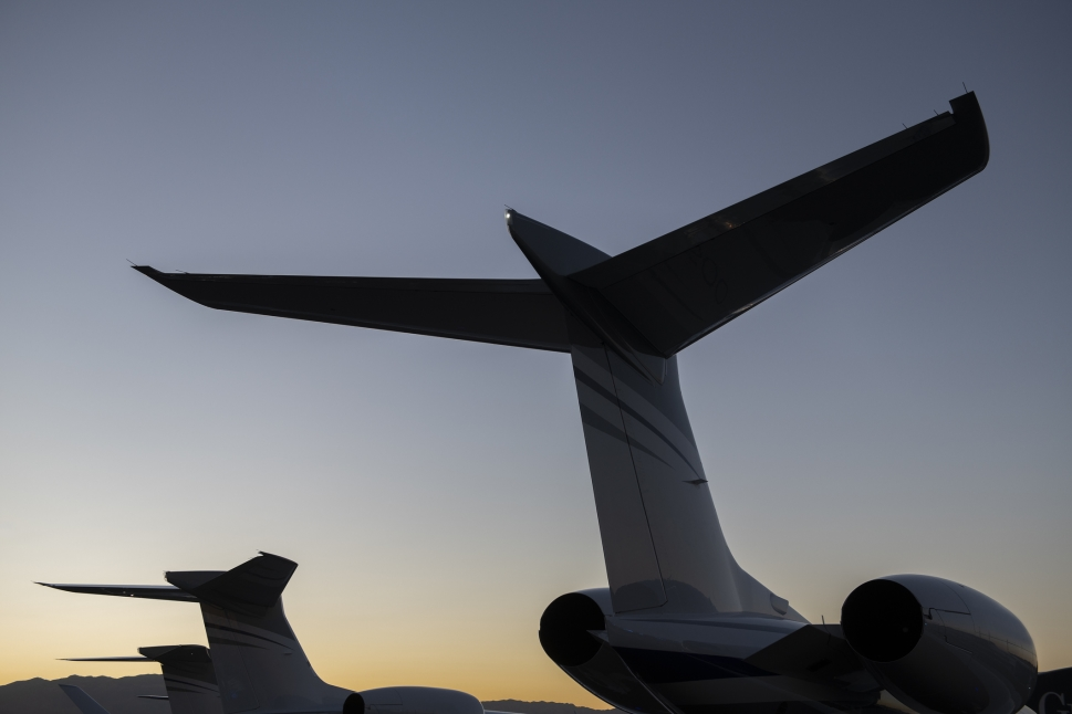 Gulfstream private jet aircraft tales lined up at sunset
