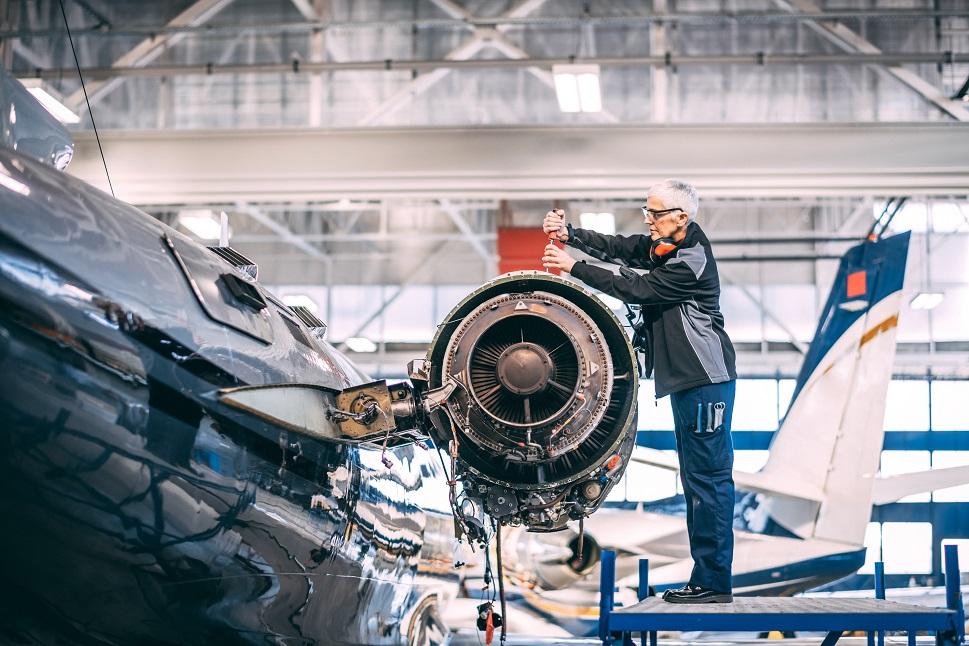 A private jet mechanic overhauls an engine