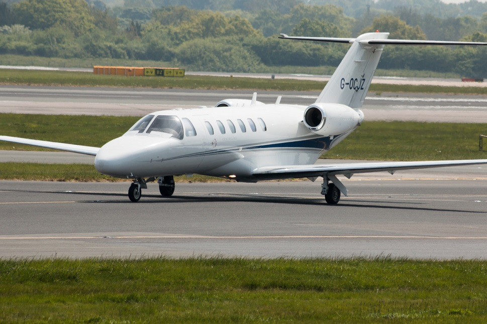 Cessna Ciation CJ2 taxis away from the runway after landing