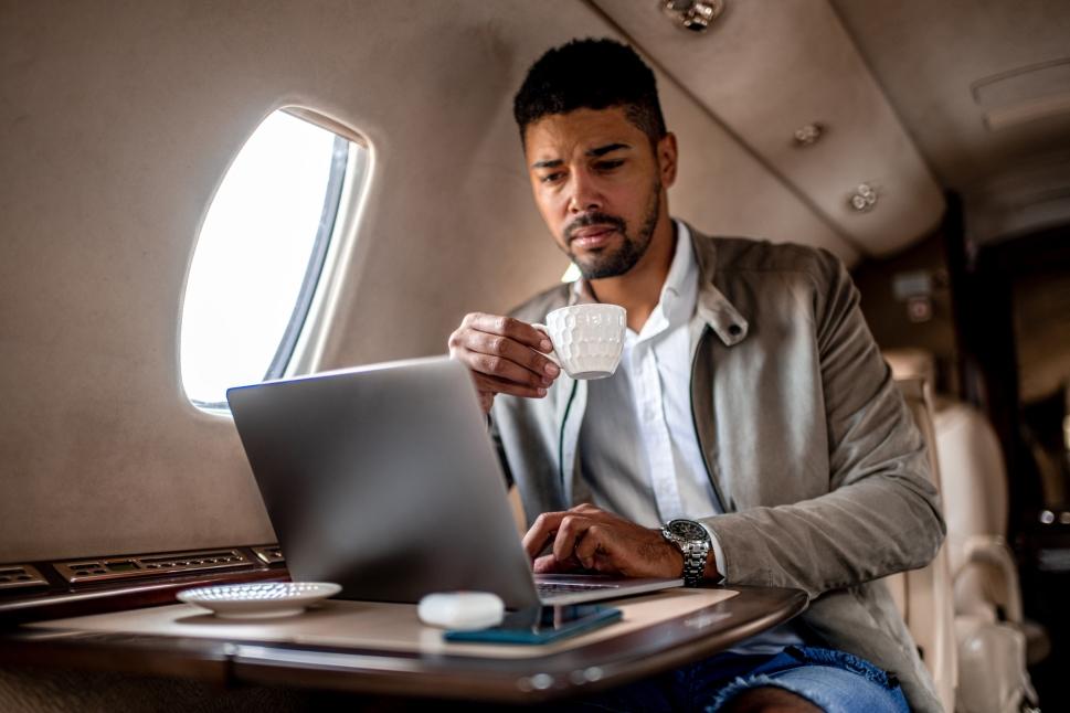 Business executive works aboard a Cessna Citation jet
