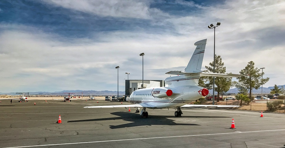 Dassault Falcon private jet parked on airport ramp