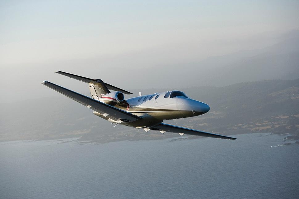 Cessna Citation CJ1+ Light Jet flying near coastline