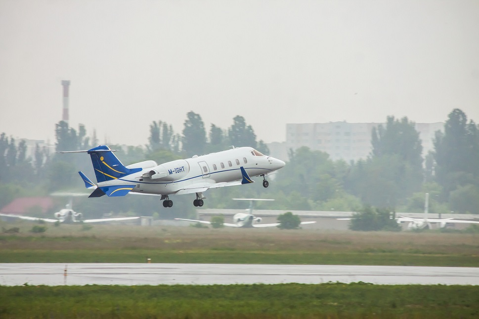 Bombardier Learjet 60 taking off on a rainy day