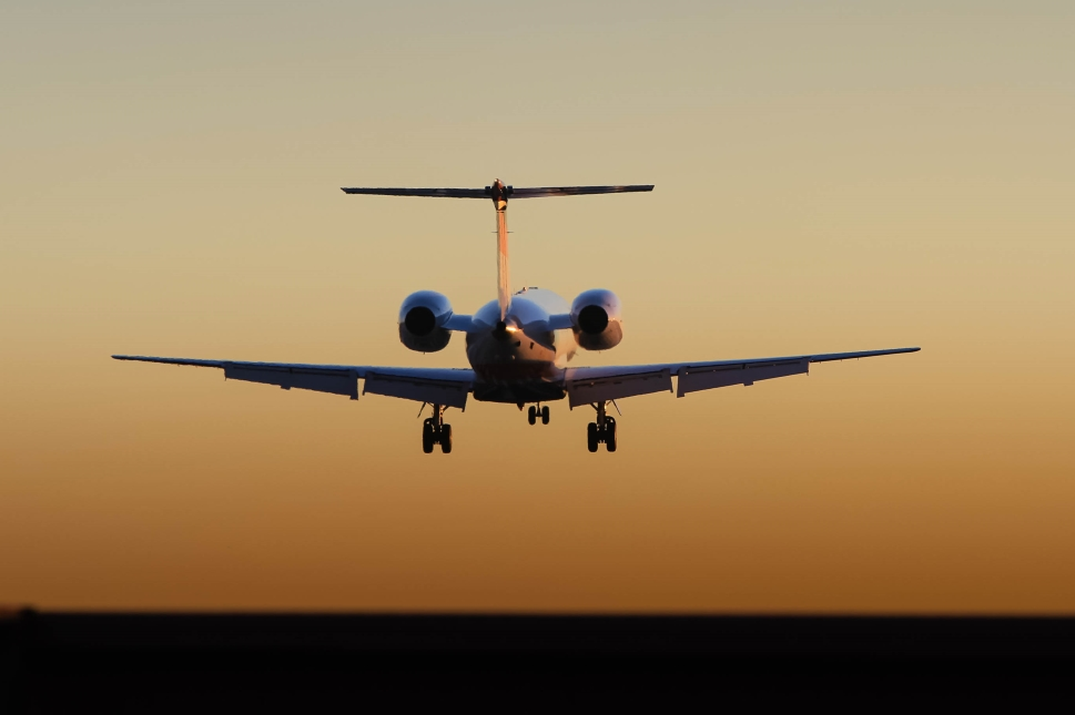 Private jet comes in to land at sunset