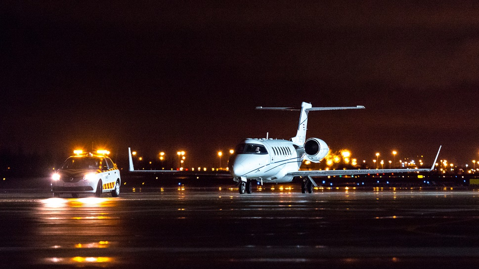 Bombardier Learjet 40XR private jet taxis towards airport ramp