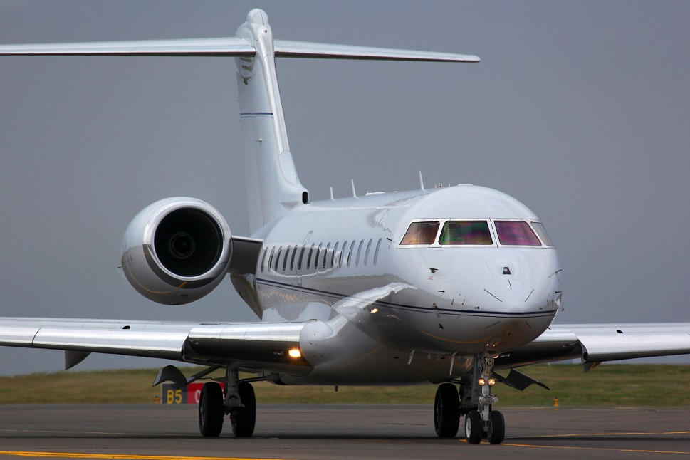 A Bombardier Global business jet taxis towards runway