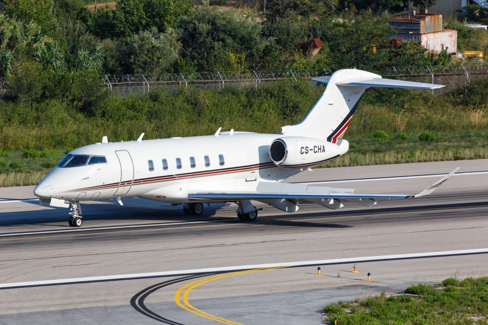 Bombardier Challenger Private Jet taxis next to the runway