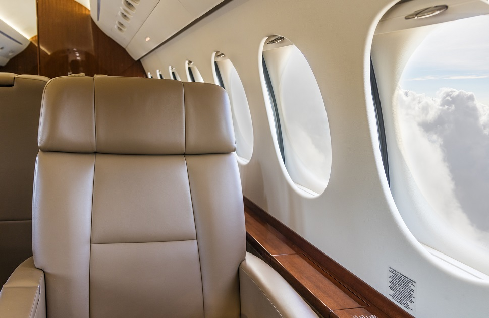 An unoccupied passenger seat aboard a private jet