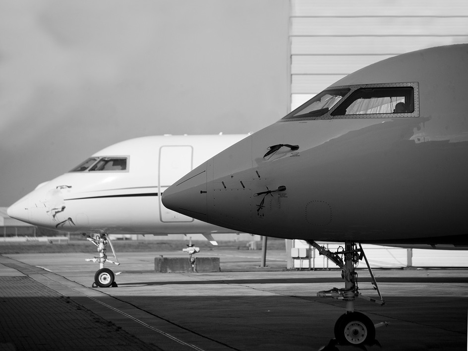 Pair of large cabin private jets parked next to each other