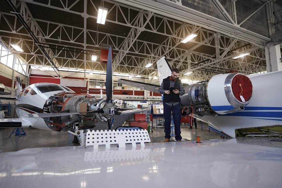 Private airplanes being maintained in an MRO hangar