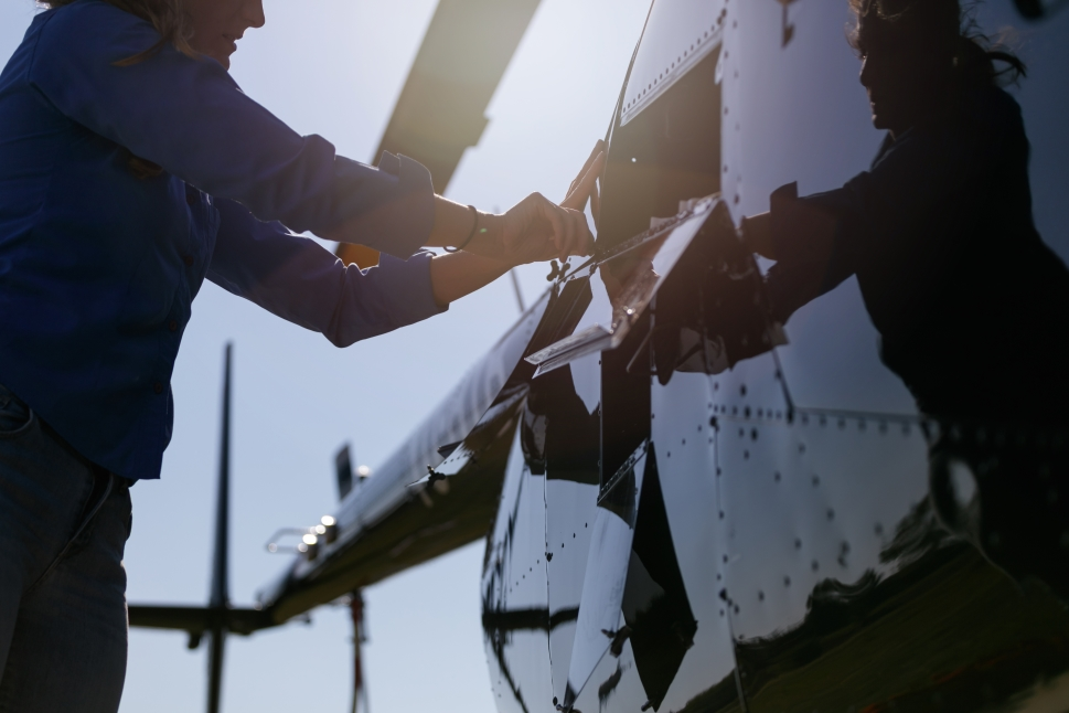 Aircraft Mechanic Repairing a Corporate Helicopter