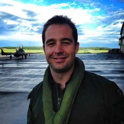 Andrew Gratton standing in airfield