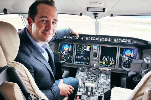 Andrew Gratton sitting in cockpit