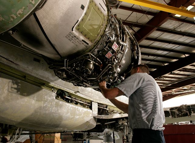 Aircraft Mechanic with Jet Engine
