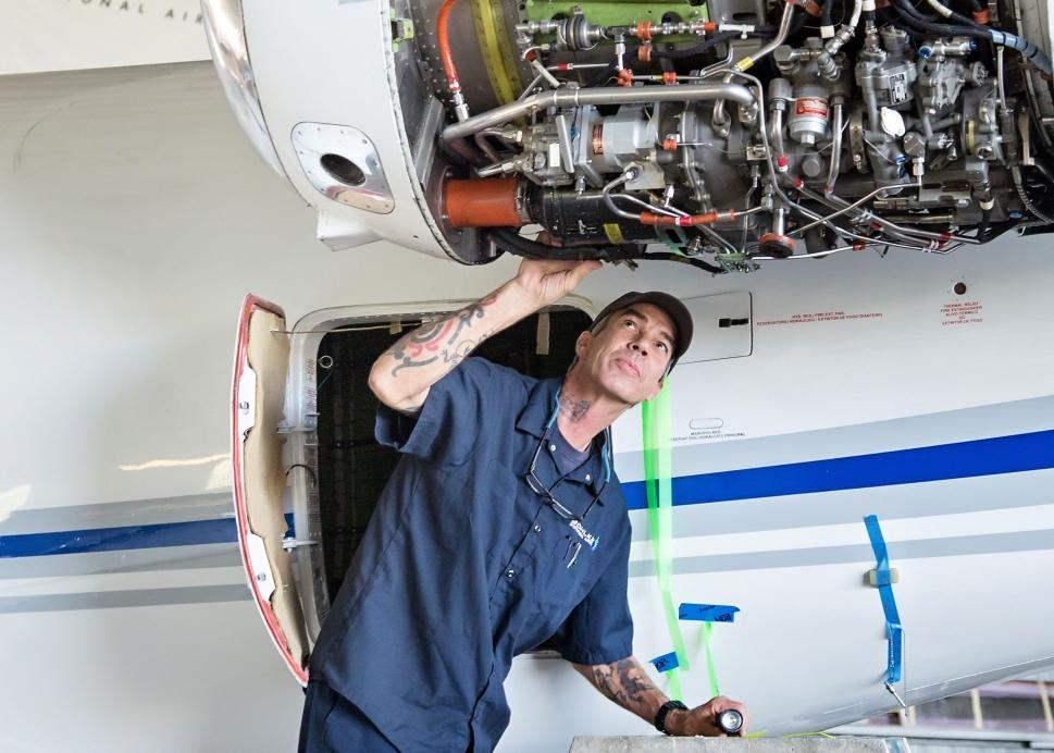 Bohlke Mechanic works on Private Jet Engine