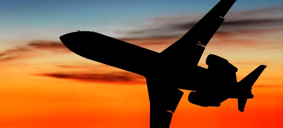 Business Jet Flies Overhead in Sunset