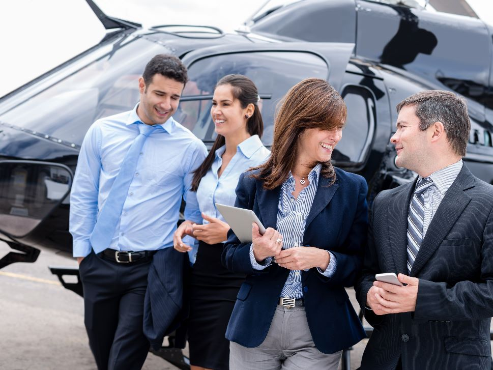 Corporate team with VIP helicopter