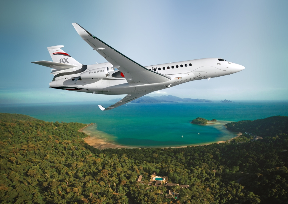 Dassault Falcon 8X flies over shoreline