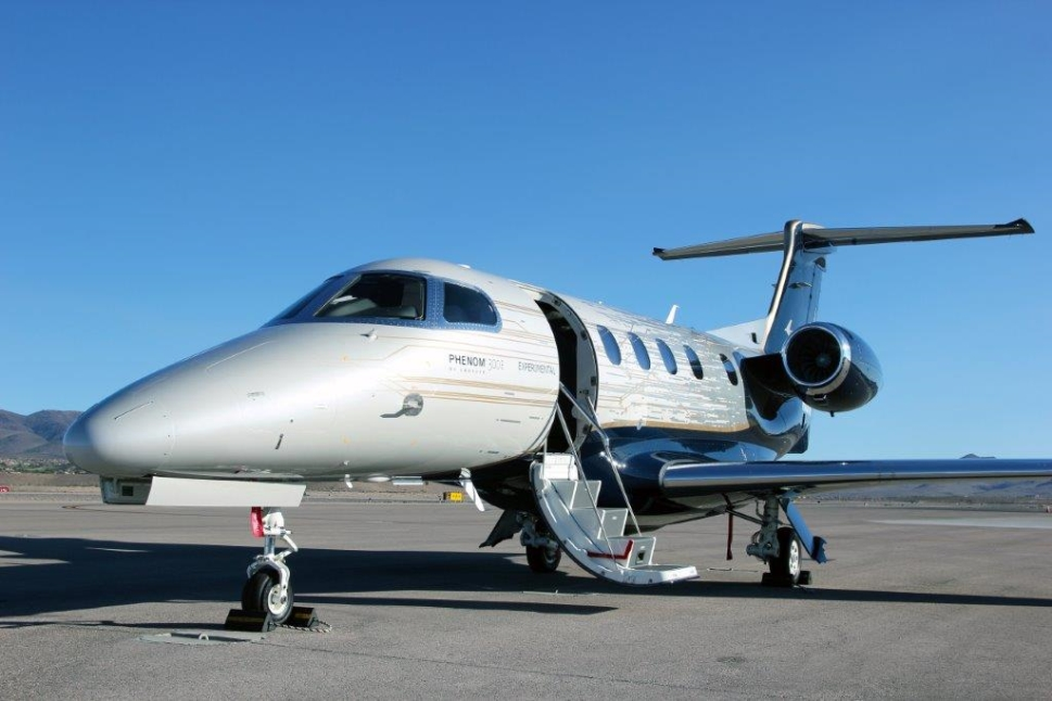 Embraer Phenom 300E Private Jet Parked Alone on Airport Ramp
