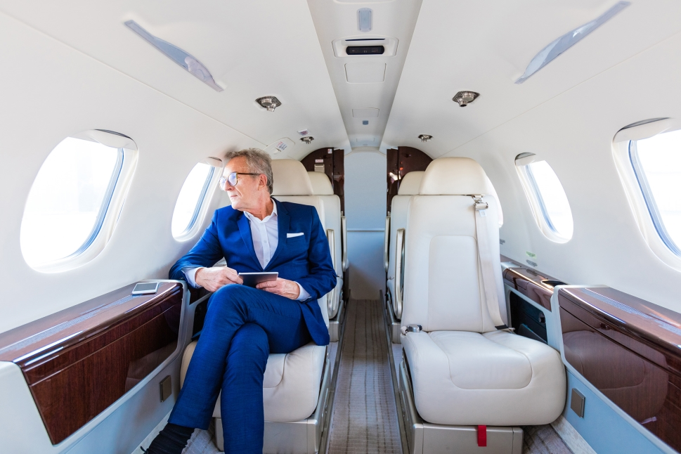 Executive sits in a business jet cabin