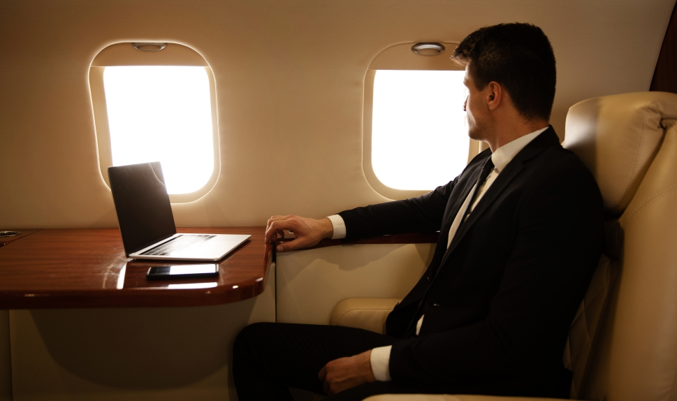 Executive Seated Aboard Business Jet