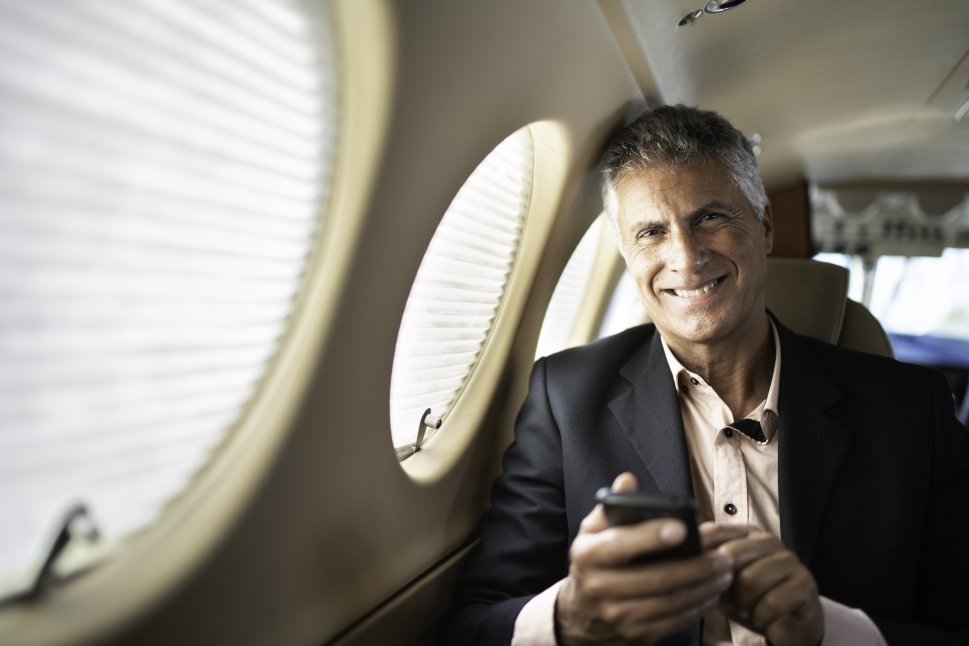 Executive sits in Beechcraft King Air cabin