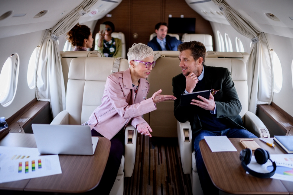 Business Aviation Passengers Work aboard a Private Jet