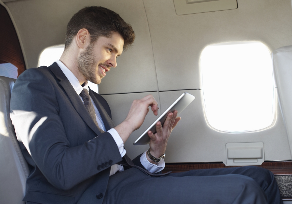 Gogo Business Aviation Cybersecurity - man with ipad on private jet