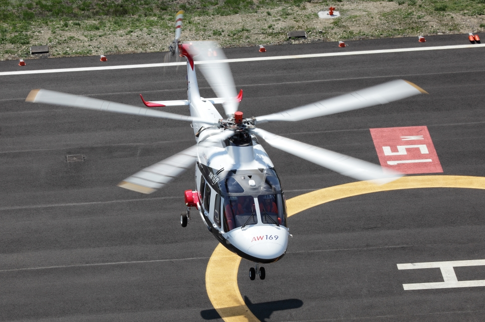 Helicopter Hovers over Helipad