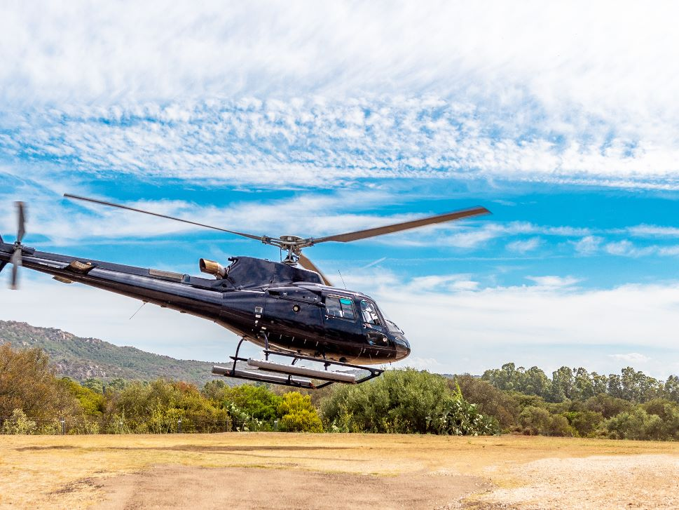 Helicopter Takes Off from a Field