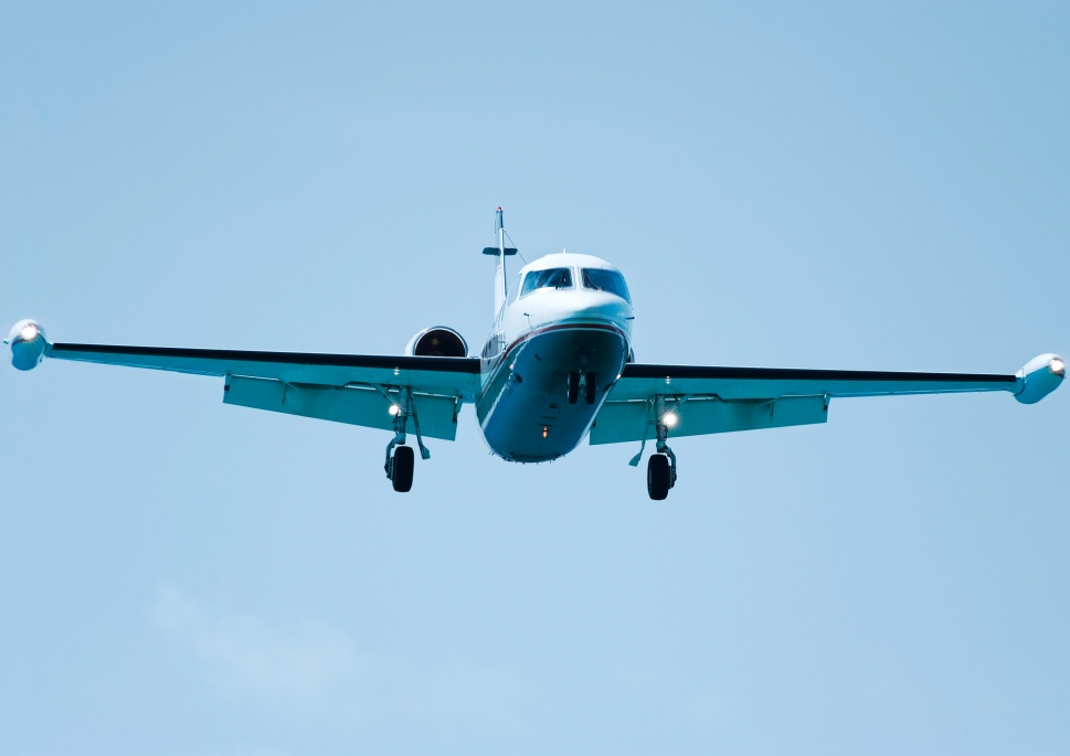 Older Private Jet Flies in to Land
