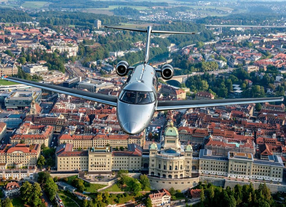 Pilatus PC-24 Private Jet Over City-scape