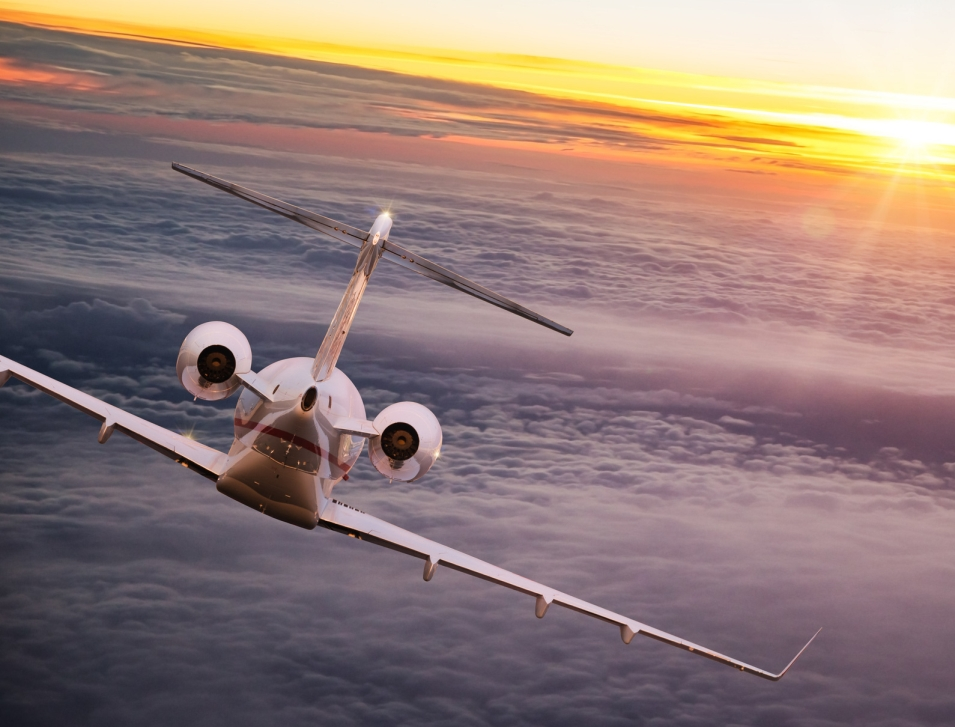 Private jet flies into a sunny horizon