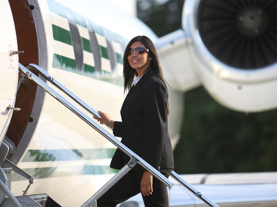 Private Jet Passenger Boards Airplane