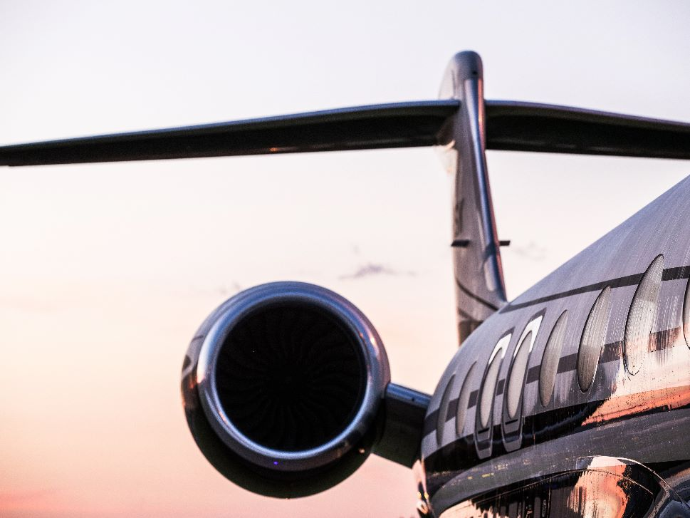 Private Jet reflects sunset skies