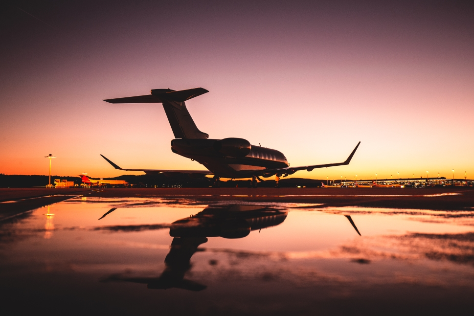 Private Jet Waits Among Puddles on Airport Ramp