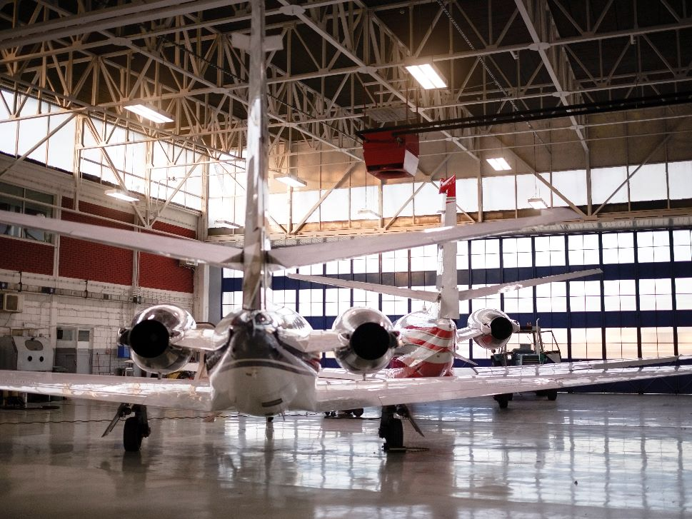 Small Jet in Hangar for Maintenance