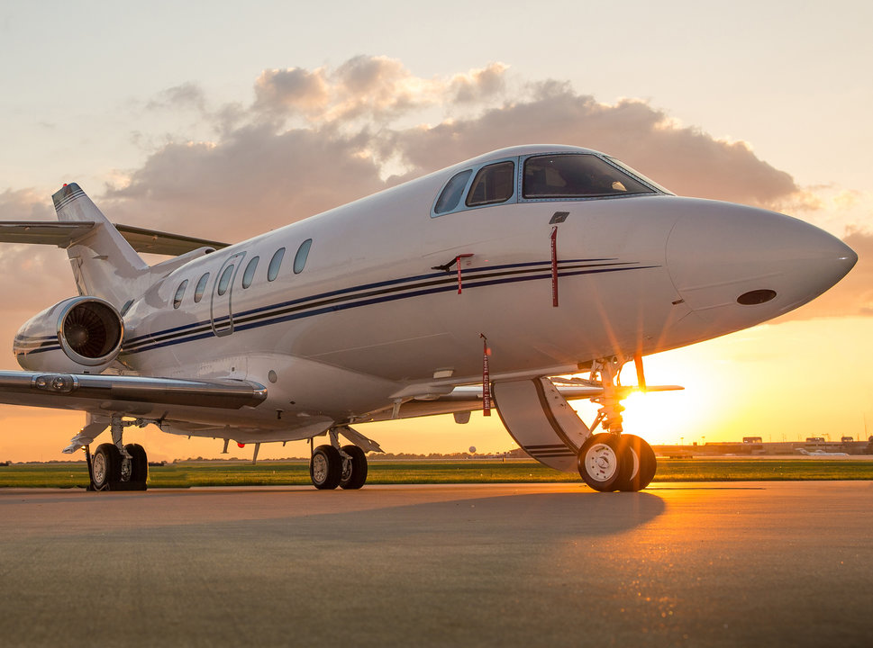 Private jet on the ramp at sunrise