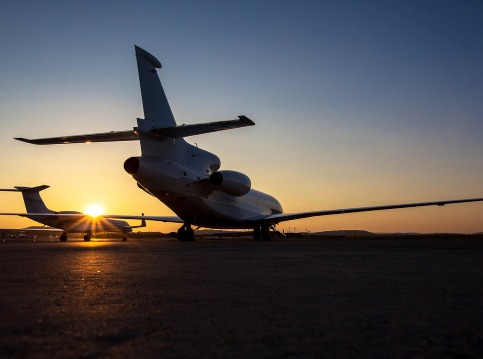 Private jets at sundown