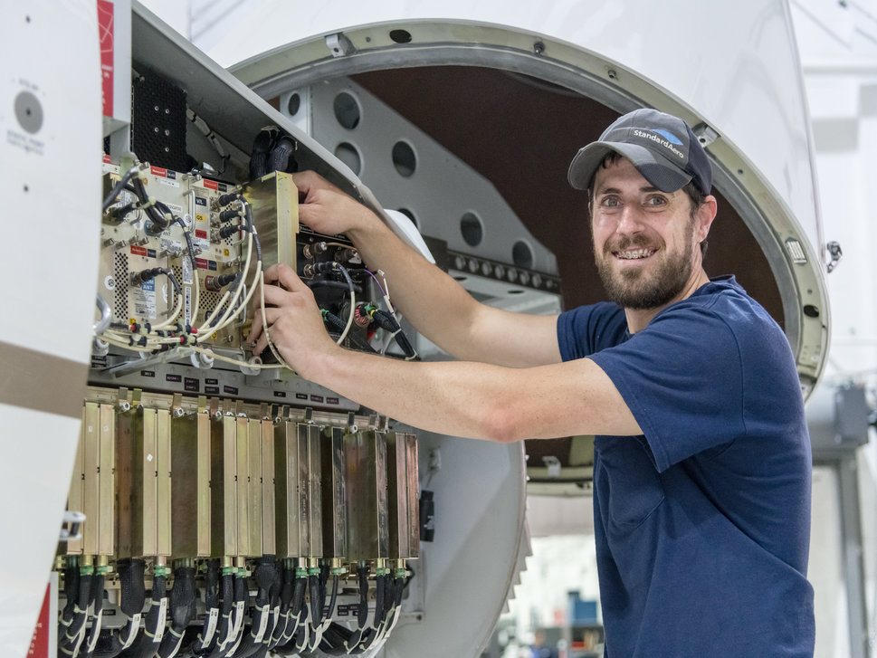 StandardAero Technician at work on a jet